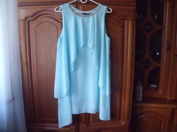 Błękitna sukienka asymetryczna 36 38