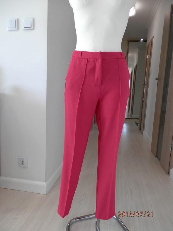 Spodnie Cygaretki w Kolorze Fuksji Wysoki Stan by UK 36