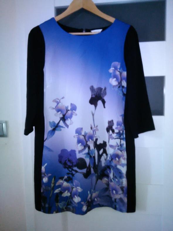 Sukienka tunika z printem i kieszeniami