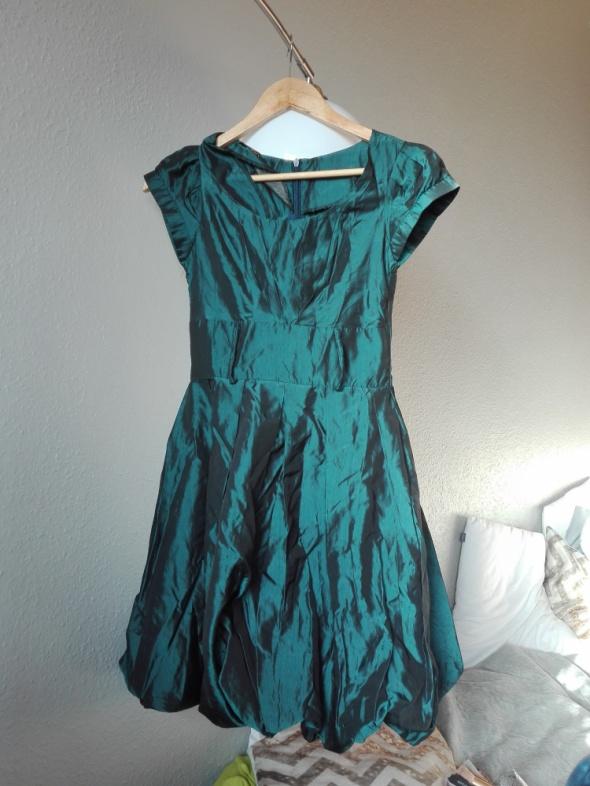 Niebieska sukienka Noix 36