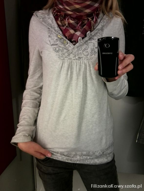 biała bluza ze stworkami...