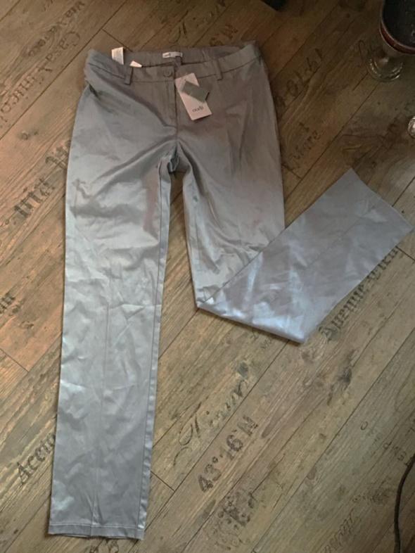 Nowe spodnie srebrne woskowane 36 38...