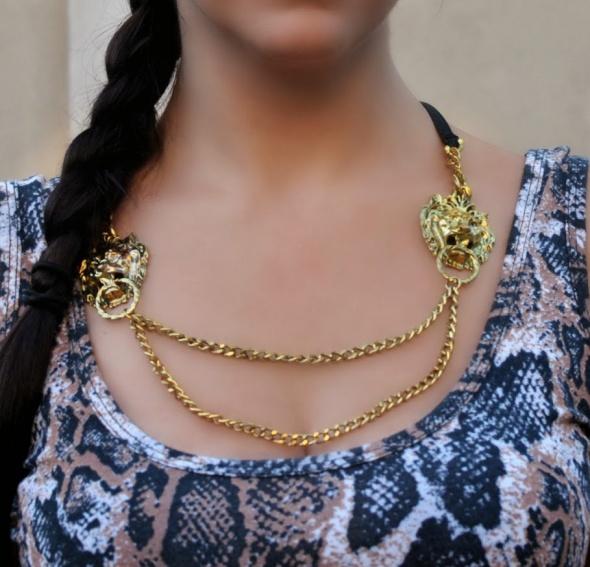 złoty naszyjnik z lwami