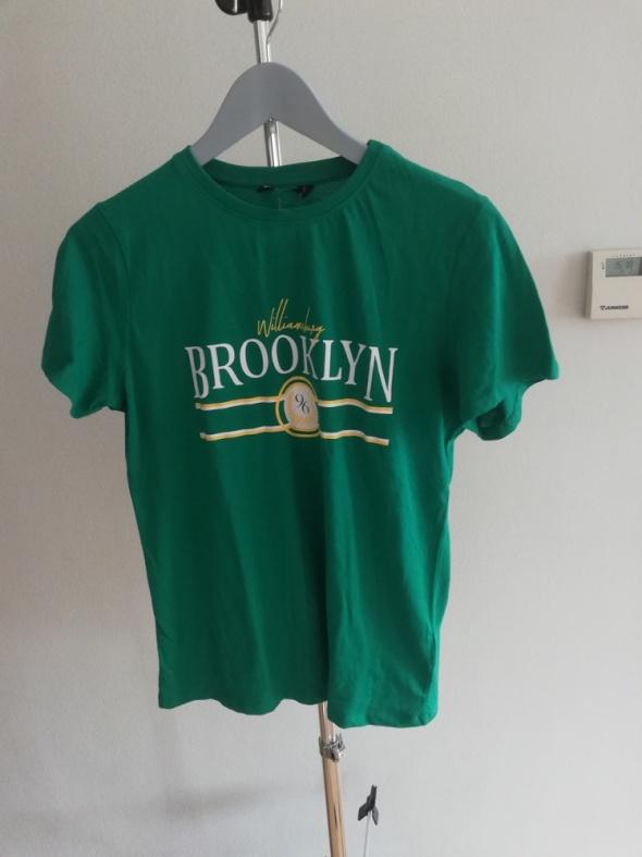 zielony t shirt