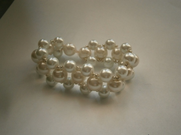 Biała bransoletka plecionagumkaślub