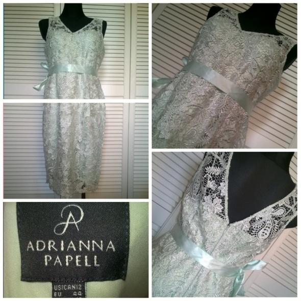 Miętowa koronkowa sukienka midi