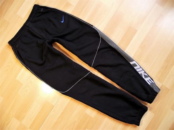 Nike ciepłe spodnie dresowe 158 do 170 lat 13 do 15...