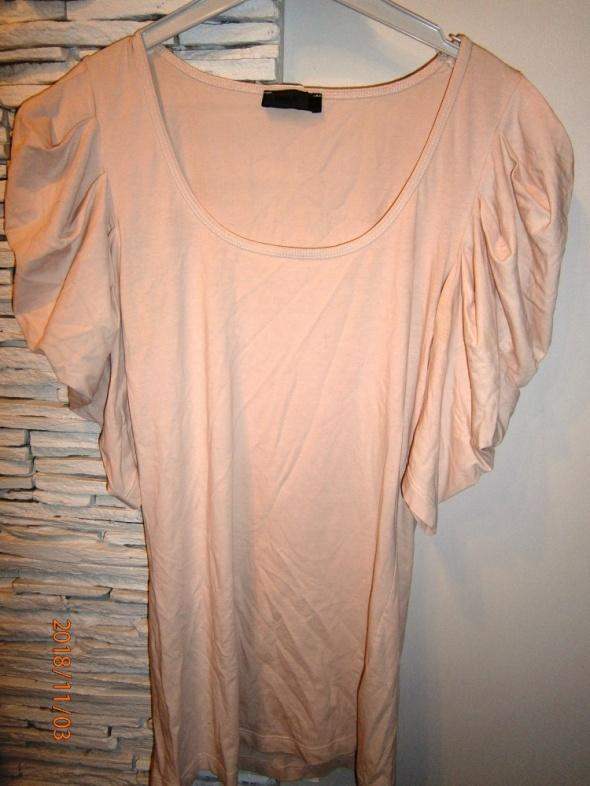bluzka w kolorze łososiowym...