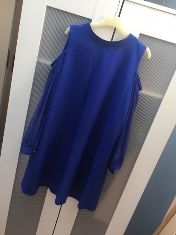 Niebieska nowa sukienka M
