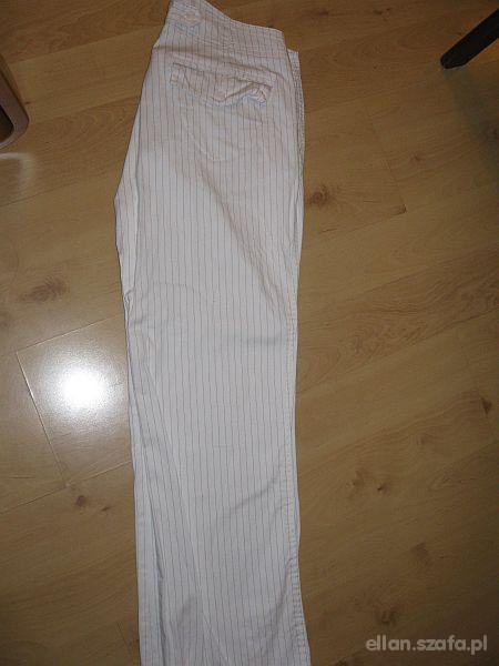 CARRY piękne białe spodnie 40