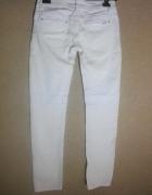 Białe elastyczne spodnie niski stan 36...
