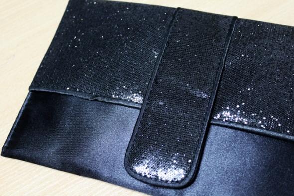 Czarna kopertówka do ręki