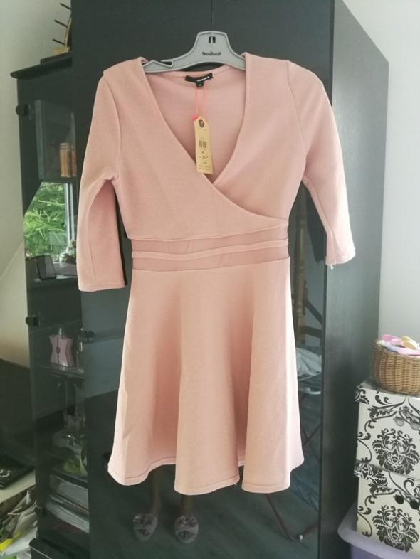 Suknie i sukienki Pudrowa kopertowa sukienka