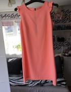 Brzoskwiniowa sukienka trapezowa z kokardką...