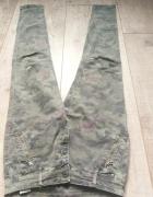 Spodnie rurki moro w róże rozmiar S...