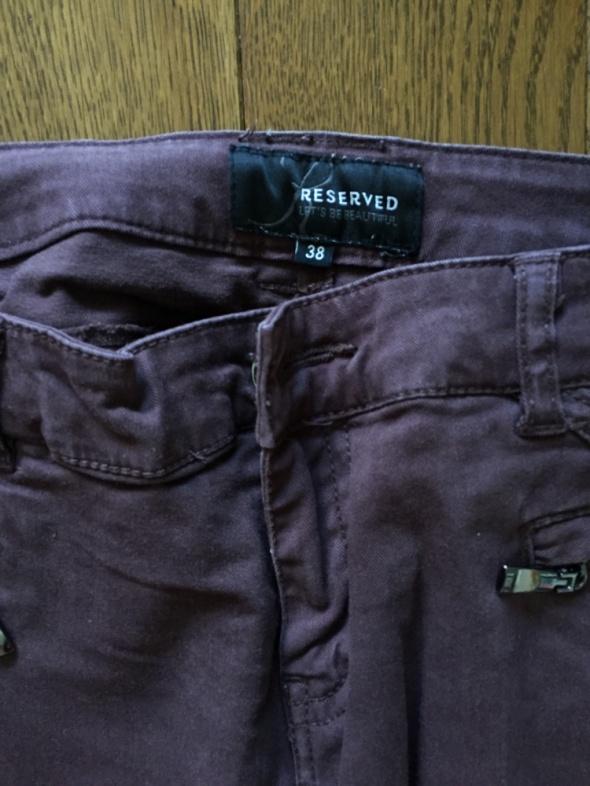 Spodnie Ciemnobrązowe spodnie RESERVED rozm 38