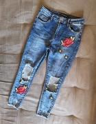Spodnie rurki dziury naszywki kwiaty 38...