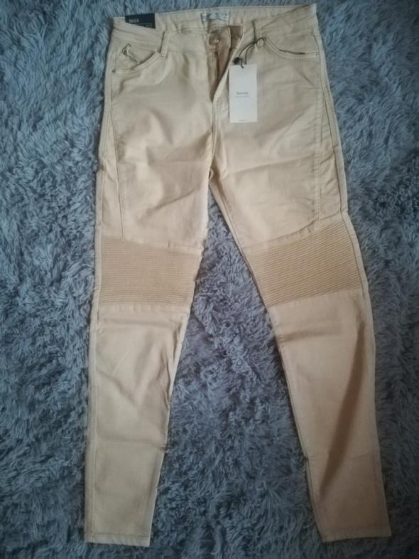 brzoskwiniowe spodnie Bershka 38 M...