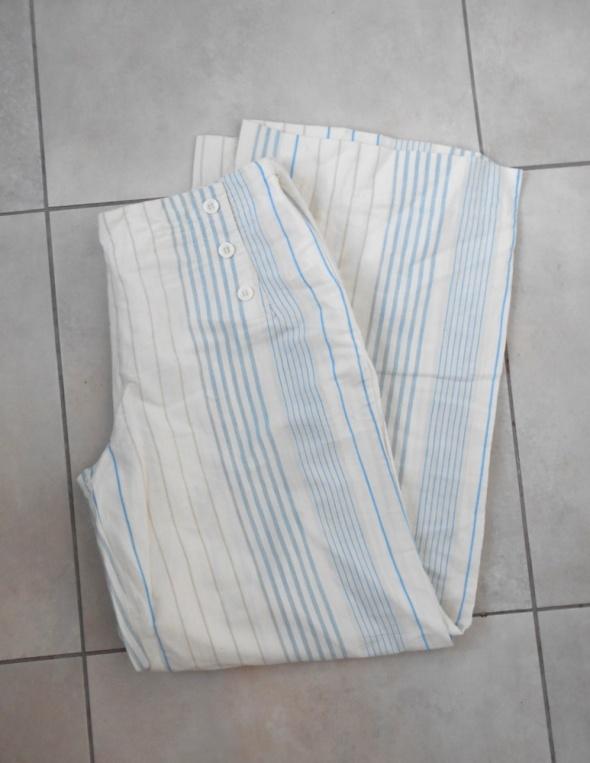 Peppercorn szerokie kremowe spodnie paski prążki...