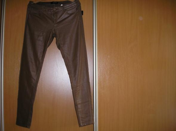 spodnie eco skóra 38 Reserved...