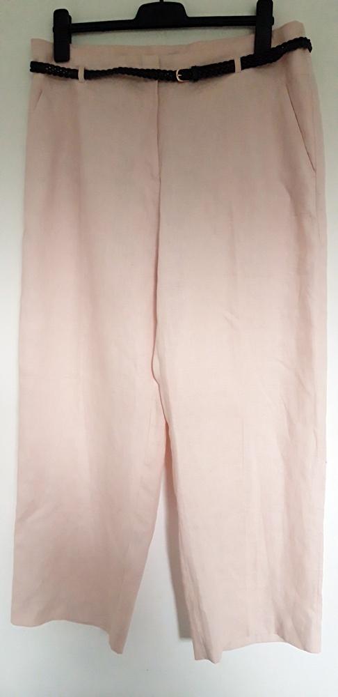 różowe spodnie H&M 46