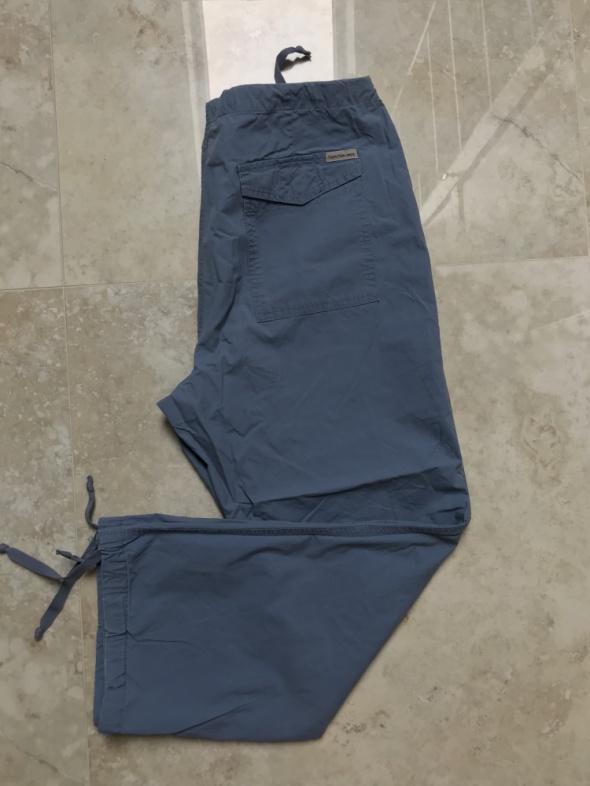 Spodnie Calvin Klein niebieskie lekkie z kieszeniami