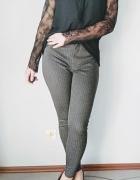 eleganckie spodnie zwężane w jodełkę wysoki stan