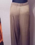 Szerokie wygodne jedwabiste spodnie HM w kolorze starego złota ...