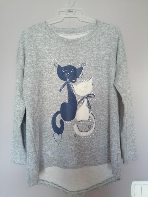 Sweterek...