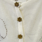 Bezowy swetere z haftem ozdobne guziki rozpinany