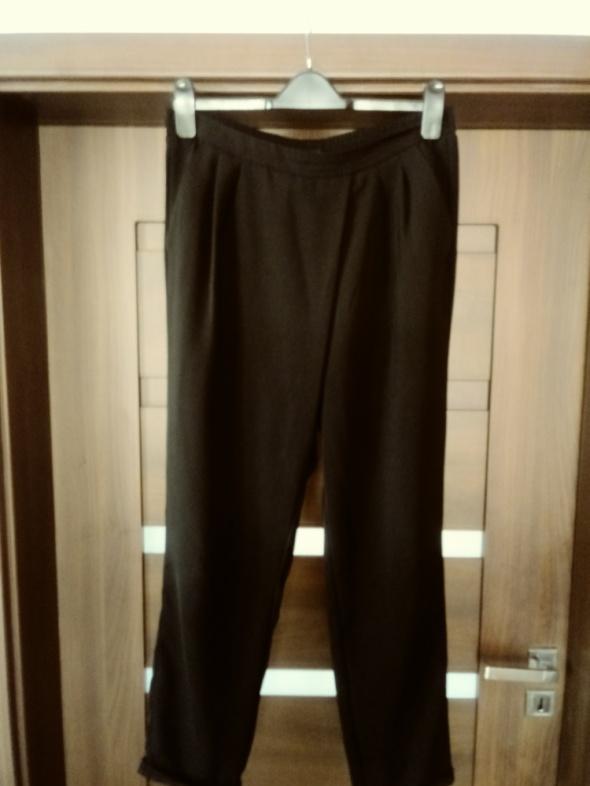Spodnie Eleganckie czarne spodnie reserved 42