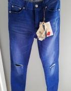 Stradivarius jeansy skinny fit cropped z przetarcia 34...
