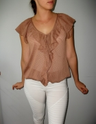 Elegancka bluzka beżowa z falbanami transparentna...
