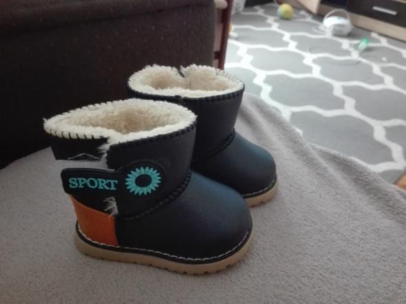 Zimowe buty chłopiec...