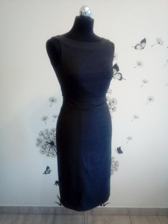 Sukienka w szarą krateczkę H&M w rozmiarze XS...