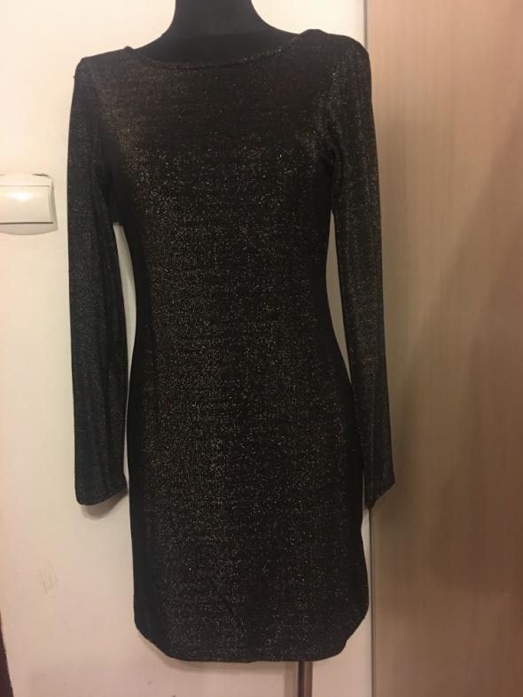 Śliczna nowa sukienka brokat M na L