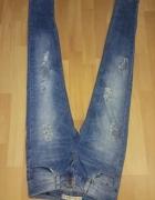 Spodnie jeansy damskie RURKI z dziurami i przeytarciami...