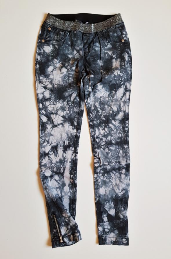 KappAhl jeansy elastyczne marmurkowe dla dziewczynki rozm 152