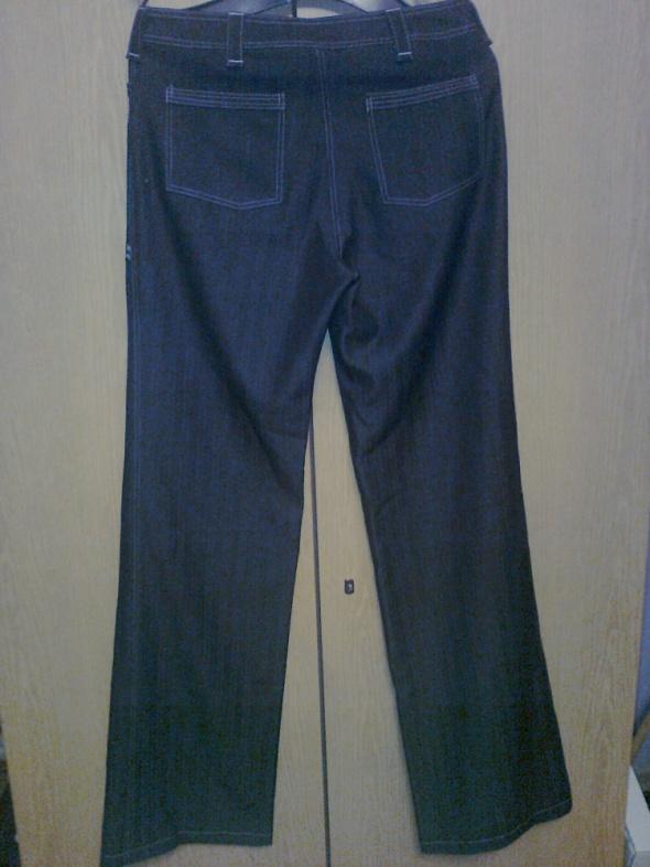 eleganckie spodnie w paski