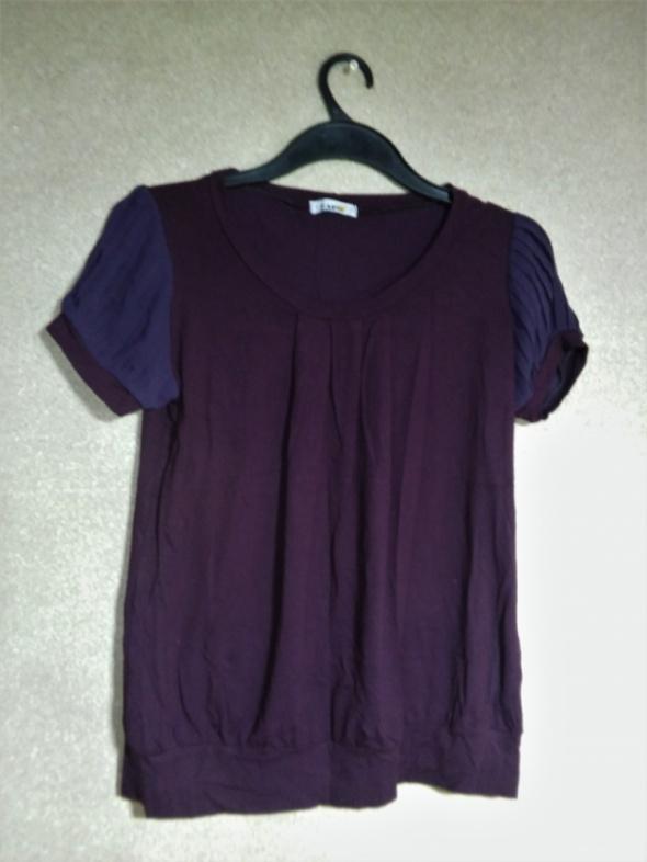 Fioletowa elastyczna bluzka z prześwitującymi ręk