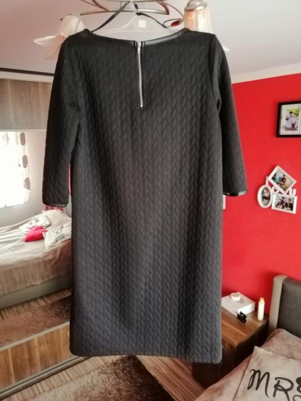 Elegancka czarna sukienka zip
