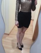 sukienka w cekiny z rękawem...