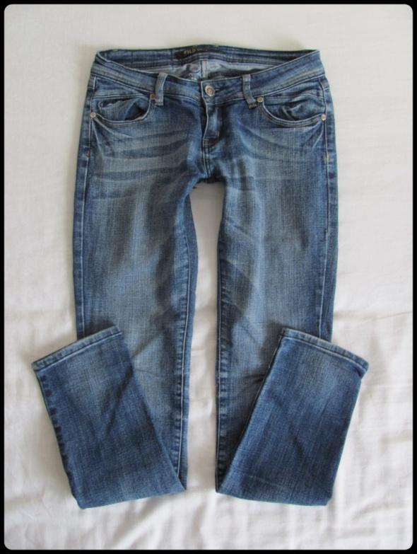 Spodnie jeansowe damskie rozmiar 30 pasują na 38 40...