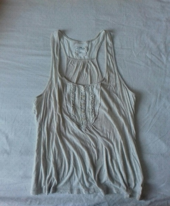 Biała bluzka z falbankami H&M...