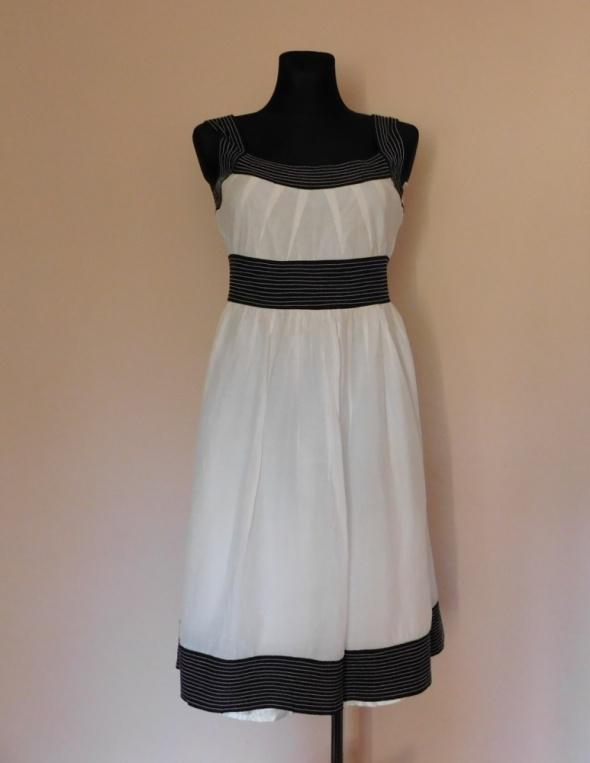 Suknie i sukienki Zara sukienka biała jedwab midi 38