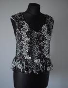 Czarna bluzka bez rękawków z baskinką w kwiaty jak retro vintag...