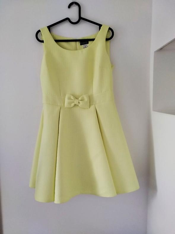Emu sukienka pastelowy żółty