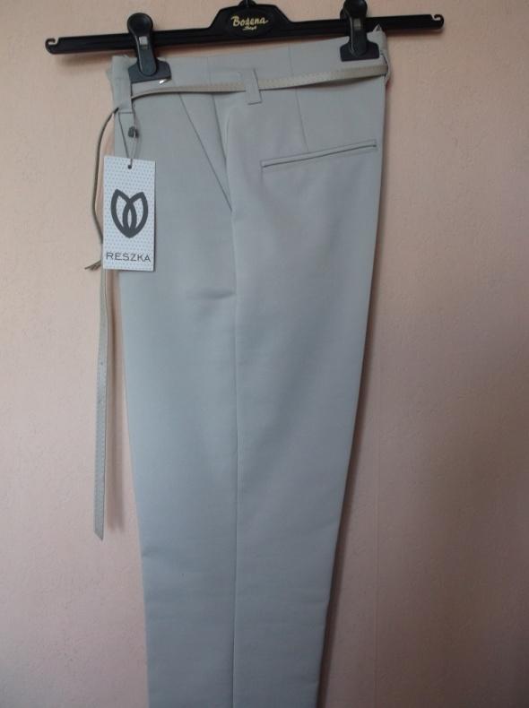 Spodnie Beżowe spodnie cygaretki Reszka 36