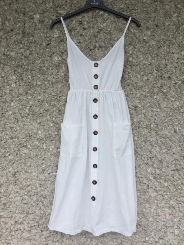 Biała sukienka kieszenie guziki midi