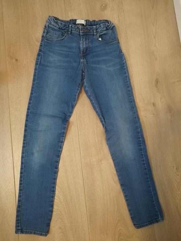 jeansowe spodnie z gumką 140 dziewczęce